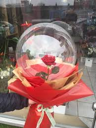 1 transparent balloon 1 red rose arrangement with red wrapping Only for Pune and Mumbai