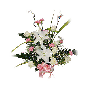 White lilies pink carnations white roses basket arrangement