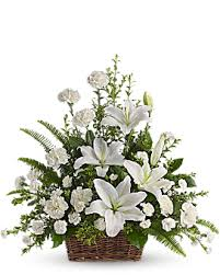 Large arrangement of Roses, liliums and carnations in a basket