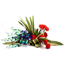 A basket of 4 Blue orchids and 8 Red carnations