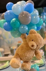 20 Gas filled Blue Balloons tied to 12 Inches brown Teddy bears hand
